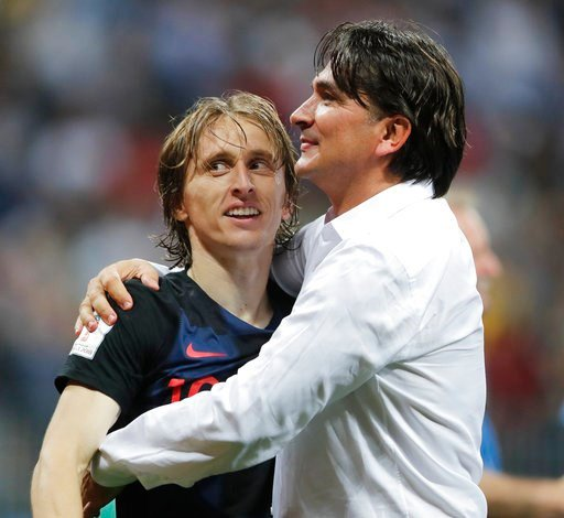 (AP Photo/Frank Augstein). Croatia head coach Zlatko Dalic, right, celebrates with Luka Modric after his team advanced to the final during the semifinal match between Croatia and England at the 2018 soccer World Cup in the Luzhniki Stadium in Moscow, R...
