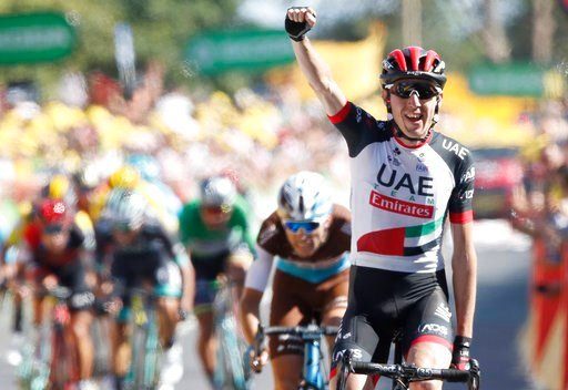 (AP Photo/Christophe Ena ). Ireland's Daniel Martin celebrates as he crosses the finish line to win the sixth stage of the Tour de France cycling race over 181 kilometers (112.5 miles) with start in Brest and finish in Mur-de-Bretagne Guerledan, France...
