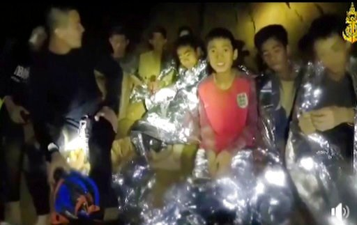 (Thai Navy Seal via AP, File). FILE - In this July 3, 2018, file image taken from video provided by the Thai Navy Seal, Thai boys are with Navy SEALs inside a cave in Mae Sai, northern Thailand. The day-to-day pearls of wisdom imparted by coaches to pl...