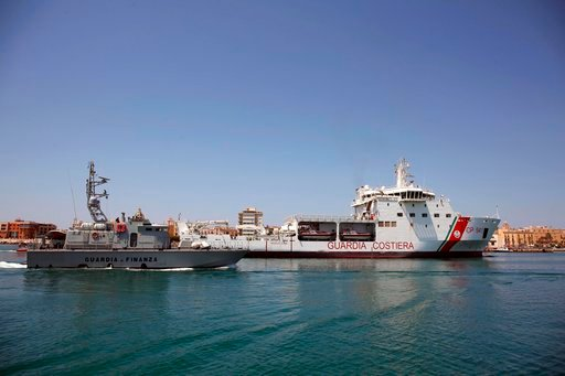 (Igor Petyx/ANSA via AP). The Diciotti ship of the Italian Coast Guard, with 67 migrants on board rescued 4 days ago by the Vos Thalassa freighter, enters the Sicilian port of Trapani, southern Italy, Thursday, July 12, 2018. The top security officials...