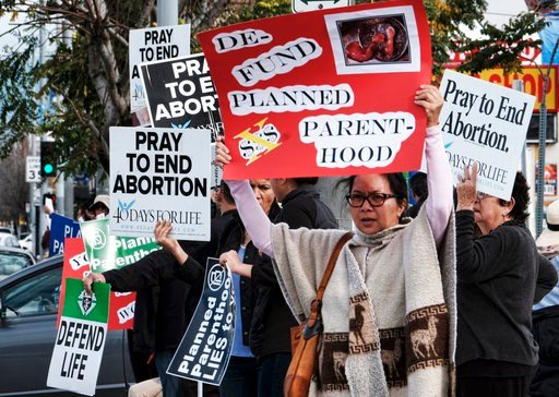(AP Photo/Richard Vogel, File). FILE - In this Feb. 11, 2017, file photo, protesters carry signs outside a Planned Parenthood health center in the Van Nuys section of Los Angeles. If a Supreme Court majority shaped by President Donald Trump overturns o...