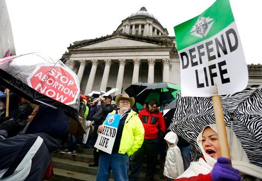 (AP Photo/Ted S. Warren, File). FILE - In this Jan. 19, 2016, file photo, demonstrators opposing abortion take part in a rally at the Capitol, in Olympia, Wash. If a Supreme Court majority shaped by President Donald Trump overturns or weakens the right...