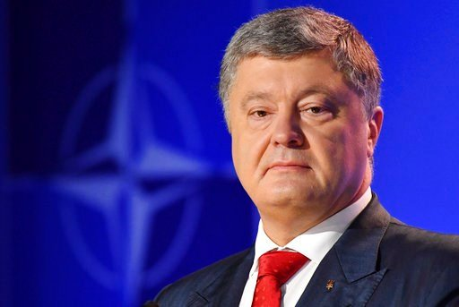 (AP Photo/Geert Vanden Wijngaert). Ukraine's President Petro Poroshenko attends a press conference with NATO Secretary-General Jens Stoltenberg during a summit of heads of state and government at NATO headquarters in Brussels, Belgium, Thursday, July 1...