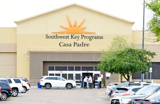 (Miguel Roberts /The Brownsville Herald via AP, File). In this June 18, 2018 file photo, dignitaries take a tour of Southwest Key Programs Casa Padre, a U.S. immigration facility in Brownsville, Texas.