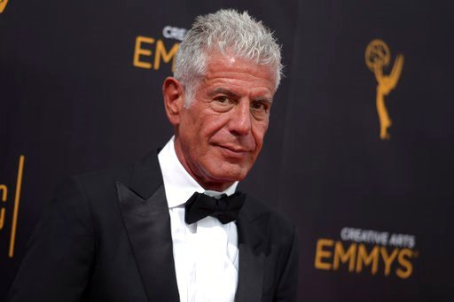 (Photo by Richard Shotwell/Invision/AP, File). FILE - In this Sept. 11, 2016 file photo, Anthony Bourdain arrives at night two of the Creative Arts Emmy Awards in Los Angeles. Bourdain, who took his life in June, received several posthumous Emmy nomina...
