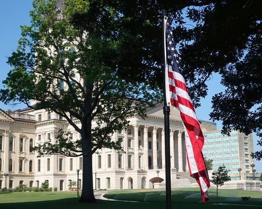 (AP Photo/John Hanna). One of an additional 19 flags flies outside the Kansas Statehouse on its north side, Thursday, July 12, 2018, in Topeka, Kan. Gov. Jeff Colyer ordered the flying of the additional flags in response to a now-relocated public art d...