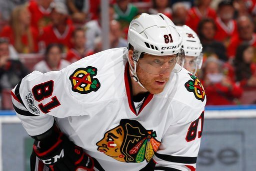 (AP Photo/Joel Auerbach, File). FILE - In this March 25, 2017, file photo, Chicago Blackhawks right wing Marian Hossa (81) prepares for a face off against the Florida Panthers during the first period of an NHL hockey game, in Sunrise, Fla. The Chicago ...
