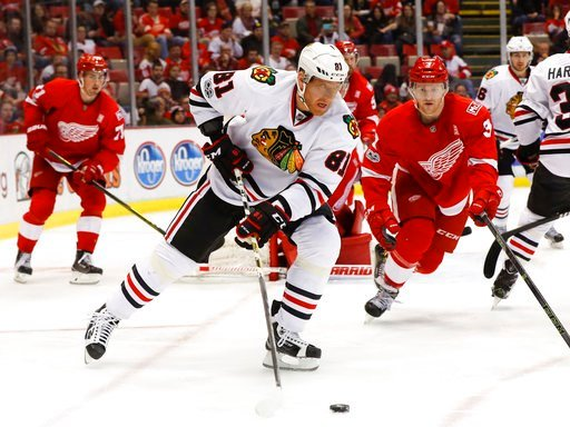 (AP Photo/Paul Sancya, File). FILE - In this March 10, 2017, file photo, Chicago Blackhawks right wing Marian Hossa (81) carries the puck against the Detroit Red Wings in the third period of an NHL hockey game, in Detroit. The Chicago Blackhawks have t...
