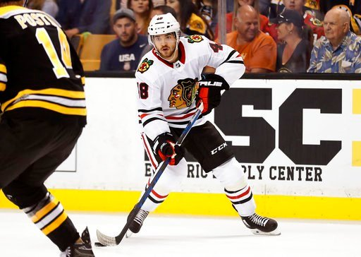 (AP Photo/Winslow Townson, File). FILE - In this Sept. 25, 2017, file photo, Chicago Blackhawks center Vinnie Hinostroza skaes with the puck during the first period of an NHL preseason hockey game against the Boston Bruins, in Boston. The Chicago Black...