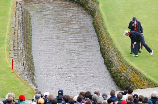 (AP Photo/Phil Noble, Pool). FILE - In this July 22, 2007, file photo, Ireland's Padraig Harrington looks down to where his ball landed in the Barry Burn during the final round of the British Open Golf Championship at Carnoustie, Scotland. Carnoustie i...