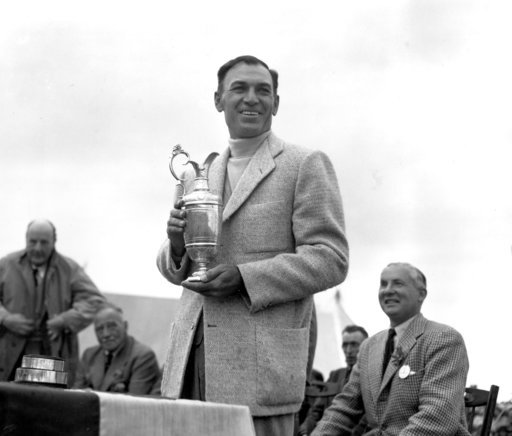 (AP Photo/Dennis Lee Royle, File). FILE - In this July 10, 1953, file photo, Ben Hogan holds his trophy after winning the British Open Golf Championship at Carnoustie, Scotland. Carnoustie is known more for the calamity it causes than the British Open ...