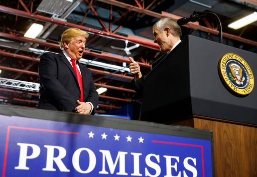 (AP Photo/Carolyn Kaster). President Donald Trump looks to GOP Senate candidate Matt Rosendale giving him the thumbs-up during a rally at the Four Seasons Arena at Montana ExpoPark, Thursday, July 5, 2018, in Great Falls, Mont., in support of Rep. Greg...