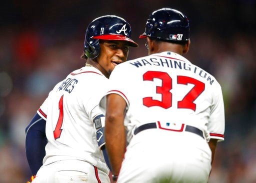 (AP Photo/Todd Kirkland). Atlanta Braves' Ozzie Albies (1) rounds third and shakes hands with third base coach Ron Washington (37) after hitting a solo home run during the sixth inning of a baseball game against the Toronto Blue Jays, Wednesday, July 1...