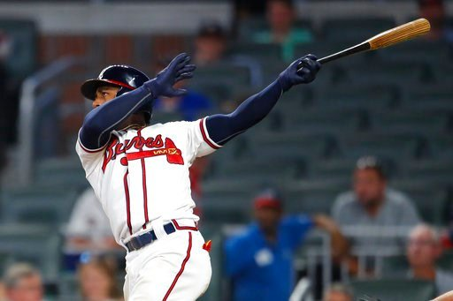 (AP Photo/Todd Kirkland). Atlanta Braves' Ozzie Albies watches his two-run home run in the eighth inning of a baseball game against the Toronto Blue Jays, Wednesday, July 11, 2018, in Atlanta.