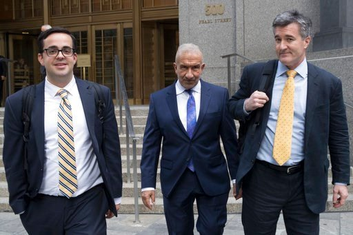 (AP Photo/Mary Altaffer). Alain Kaloyeros, center, a former president of the State University of New York's Polytechnic Institute, leaves Federal court where he is on trial on corruption charges, Wednesday, July 11, 2018, in New York. The case involves...