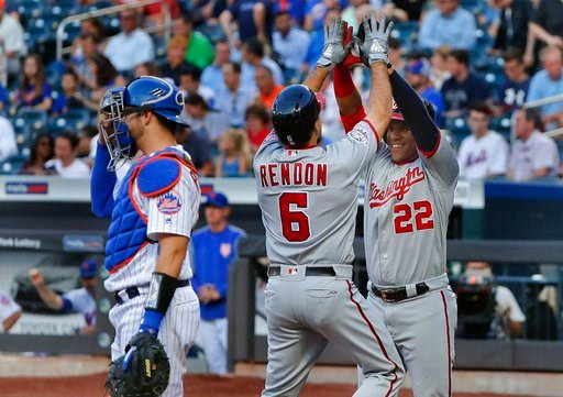(AP Photo/Julie Jacobson). Washington Nationals' Anthony Rendon (6) is congratulated by Juan Soto after hitting a two-run home run against the New York Mets during the first inning of a baseball game Thursday, July 12, 2018, in New York.