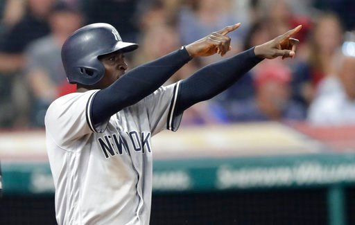 (AP Photo/Tony Dejak). New York Yankees' Didi Gregorius looks toward Aaron Hicks at second base after Gregorius scored on a double by Hicks during the eighth inning of a baseball game against the Cleveland Indians, Thursday, July 12, 2018, in Cleveland.