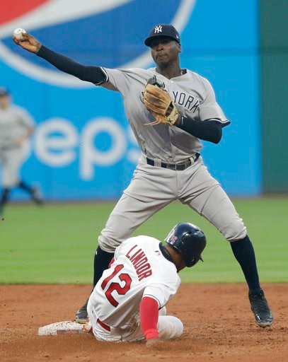 (AP Photo/Tony Dejak). New York Yankees' Didi Gregorius throws to first base after getting Cleveland Indians' Francisco Lindor out at second base during the fifth inning of a baseball game, Thursday, July 12, 2018, in Cleveland. Michael Brantley was ou...