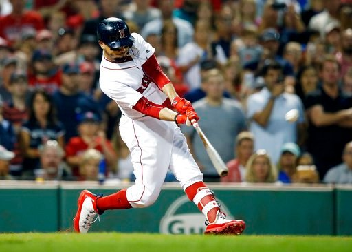 (AP Photo/Michael Dwyer). Boston Red Sox's Mookie Betts hits a grand slam during the fourth inning against the Toronto Blue Jays in a baseball game in Boston, Thursday, July 12, 2018.