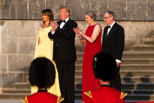 (Will Oliver/Photo via AP). From left, first lady Melania Trump, President Donald Trump, British Prime Minister Theresa May, and her husband Philip May, watch the arrival ceremony at Blenheim Palace, in Blenheim, England, Thursday, July 12, 2018.