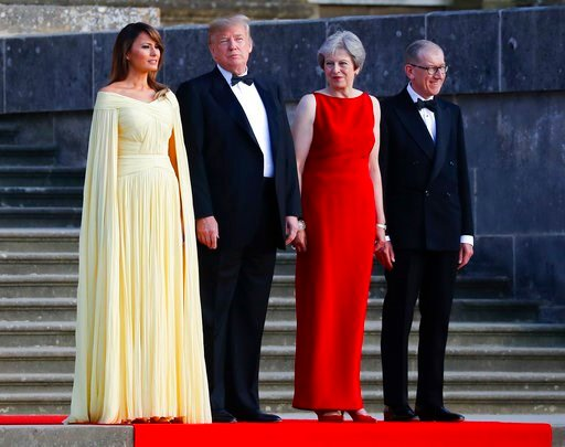 (AP Photo/Pablo Martinez Monsivais). From left, first lady Melania Trump, President Donald Trump, British Prime Minister Theresa May, and her husband Philip May, watch the arrival ceremony at Blenheim Palace, Oxfordshire, Thursday, July 12, 2018.