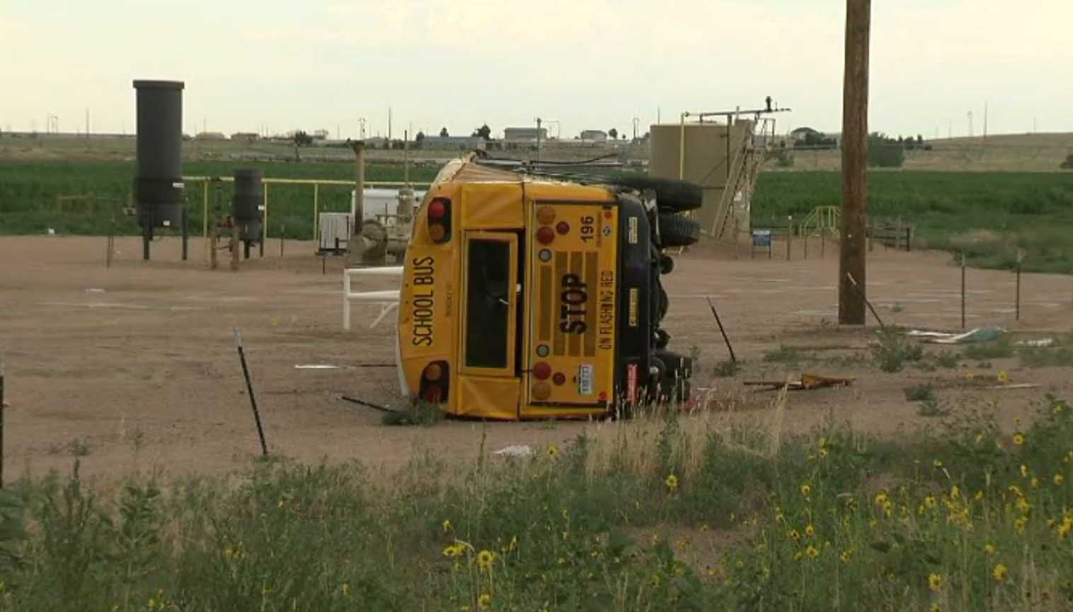 Authorities say multiple people were injured when a school bus carrying 35 high school students crashed and tipped over on a rural road northeast of Denver. (Source: KMGH via CNN)