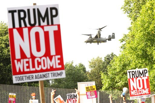 (Gareth Fuller/PA via AP). A helicopter leaves the grounds of the US ambassador residence in Regent's Park, London, while demonstrators protest against the visit of US President Donald Trump Thursday July 12, 2018.