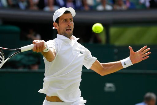 (AP Photo/Kirsty Wigglesworth). Novak Djokovic of Serbia returns the ball to Kei Nishikori of Japan during their men's quarterfinal match at the Wimbledon Tennis Championships in London, Wednesday July 11, 2018.