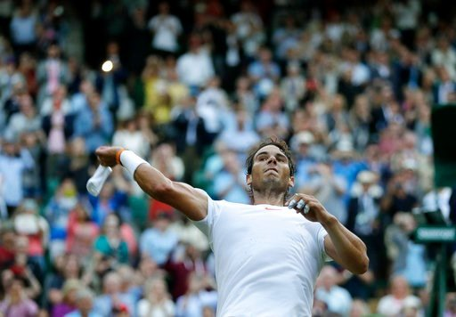 (AP Photo/Kirsty Wigglesworth). Rafael Nadal of Spain throws his wrist bands into the crowd after defeating Juan Martin Del Potro of Argentina in their men's quarterfinal match at the Wimbledon Tennis Championships in London, Wednesday July 11, 2018.