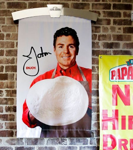 (AP Photo/Charles Krupa, File). FILE- In this Dec. 21, 2017, file photo shows signs, including one featuring Papa John's founder John Schnatter, at a Papa John's pizza store in Quincy, Mass. Papa John's plans to pull Schnatter's image from marketing ma...