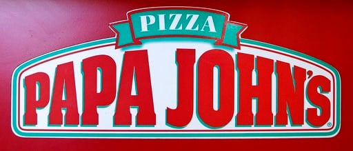 (AP Photo/Charles Krupa, File). FILE- This Dec. 21, 2017, file photo shows the logo of Papa John's is displayed at a pizza store in Quincy, Mass. Papa John's plans to pull founder John Schnatter's image from marketing materials following use of racial ...
