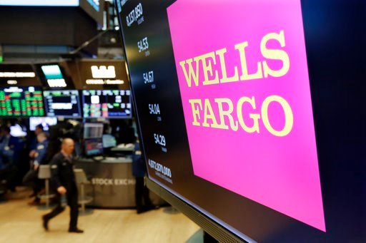 (AP Photo/Richard Drew, File). FILE- In this May 17, 2018, file photo, the logo for Wells Fargo appears above a trading post on the floor of the New York Stock Exchange. Wells Fargo reports earnings Friday, July 13, 2018.