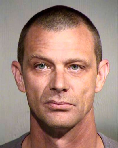 (Maricopa County Sheriff's Office via AP). This undated photo provided by the Maricopa County Sheriff's office shows Matthew Disbro. Arizona authorities say the 44-year-old uniformed security guard is accused of impersonating a police officer by trying...