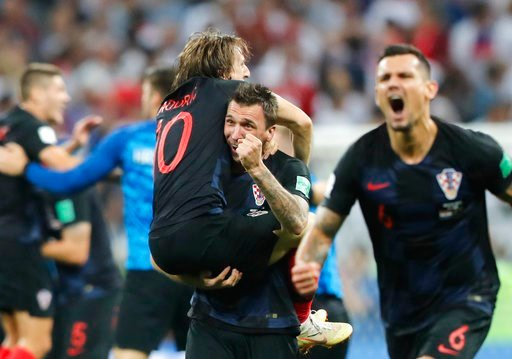 (AP Photo/Frank Augstein). Croatia's Mario Mandzukic, center, carries Luka Modric when celebrating after his team advanced to the final during the semifinal match between Croatia and England at the 2018 soccer World Cup in the Luzhniki Stadium in Mosco...