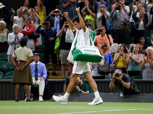 (AP Photo/Kirsty Wigglesworth). Serbia's Novak Djokovic leaves the court after play was suspended in his men's singles semifinals match against Rafael Nadal of Spain at the Wimbledon Tennis Championships, in London, Saturday July 14, 2018.