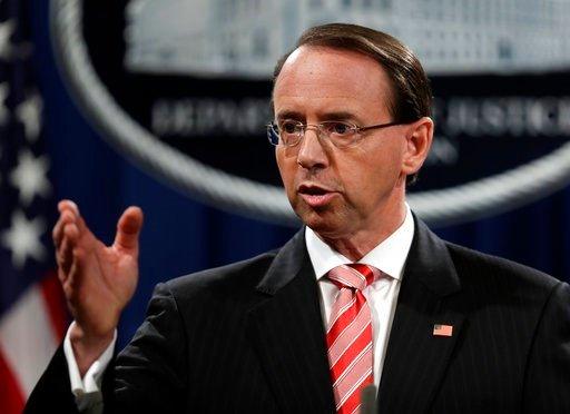 (AP Photo/Evan Vucci). Deputy Attorney General Rod Rosenstein speaks during a news conference at the Department of Justice, Friday, July 13, 2018, in Washington.