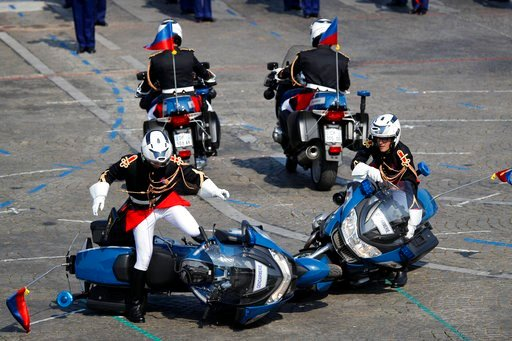 (AP Photo/Francois Mori). Two police motorcycles crash during a demonstration as part of the Bastille Day parade on the Champs Elysees avenue in Paris, France, Saturday, July 14, 2018. France's military is marching through Paris for Bastille Day celebr...