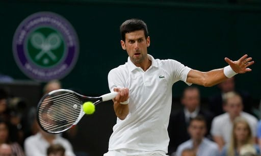 (AP Photo/Kirsty Wigglesworth). Serbia's Novak Djokovic returns the ball to Rafael Nadal of Spain during their men's singles semifinals match at the Wimbledon Tennis Championships, in London, Friday July 13, 2018.