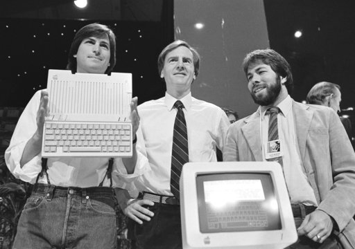 (AP Photo/Sal Veder, File). In this April 24, 1984 file photo, Steve Jobs, left, chairman of Apple Computers, John Sculley, center, president and CEO, and Steve Wozniak, co-founder of Apple, unveil the new computer.