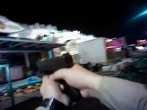 (Las Vegas Metropolitan Police Department via AP). In this Sunday, Oct. 1, 2017, image taken from police body cam video released Wednesday, July 25, 2018, by the Las Vegas Metropolitan Police Department, an armed law enforcement official points his gun...