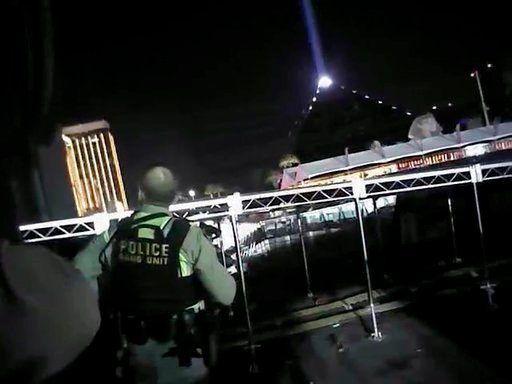 (Las Vegas Metropolitan Police Department via AP). In this Sunday, Oct. 1, 2017, image taken from police body cam video released Wednesday, July 25, 2018, by the Las Vegas Metropolitan Police Department, an armed law enforcement official stands at the ...