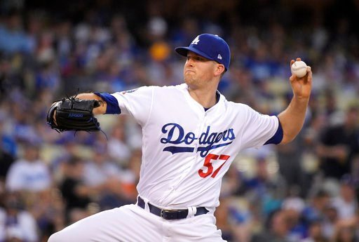 (AP Photo/Mark J. Terrill). Los Angeles Dodgers starting pitcher Alex Wood throws during the first inning of the team's baseball game against the Houston Astros on Friday, Aug. 3, 2018, in Los Angeles.