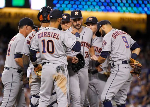 (AP Photo/Mark J. Terrill). Houston Astros starting pitcher Justin Verlander, center, is congratulated after being taken out of the baseball game during the eighth inning against the Los Angeles Dodgers on Friday, Aug. 3, 2018, in Los Angeles.