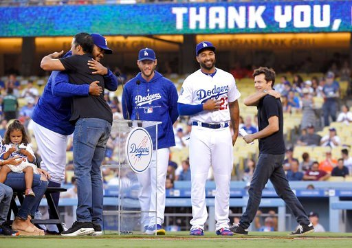 (AP Photo/Mark J. Terrill). Los Angeles Dodgers' Andre Ethier, second from eft, hugs Kenley Jansen, left, as Clayton Kershaw, center, Matt Kemp, second from right, and actor Jason Bateman stand by during a retirement ceremony for Ethier prior to a base...