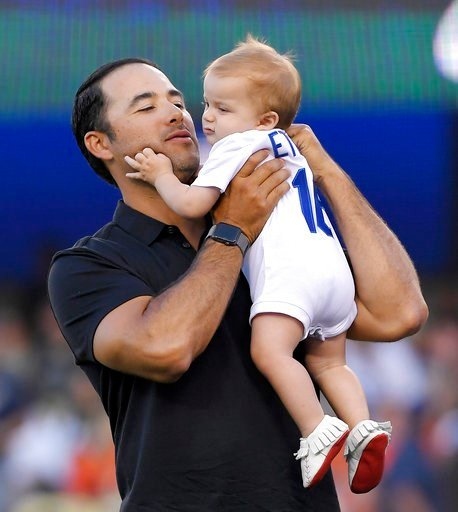(AP Photo/Mark J. Terrill). Los Angeles Dodgers' Andre Ethier holds his son Anson during a retirement ceremony for him prior to a baseball game between the Dodgers and the Houston Astros on Friday, Aug. 3, 2018, in Los Angeles.