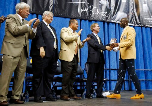 (AP Photo/Mark Humphrey). Former NFL wide receiver Terrell Owens, right, is congratulated by University of Tennessee at Chattanooga Chancellor Steve Angle after Owens delivered his Pro Football Hall of Fame speech Saturday, Aug. 4, 2018, in Chattanooga...