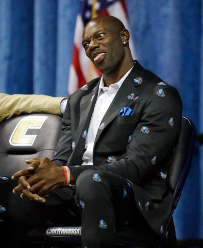 (AP Photo/Mark Humphrey). Former NFL wide receiver Terrell Owens makes a face at family members in the audience as he waits to deliver his Pro Football Hall of Fame speech Saturday, Aug. 4, 2018, in Chattanooga, Tenn. Instead of speaking at the Hall of...