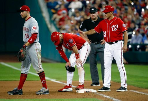 (AP Photo/Alex Brandon). Washington Nationals' Bryce Harper pauses on first base after being hit by a pitch, between Cincinnati Reds first baseman Joey Votto left, and Nationals first base coach Tim Bogar, during the sixth inning of the second baseball...