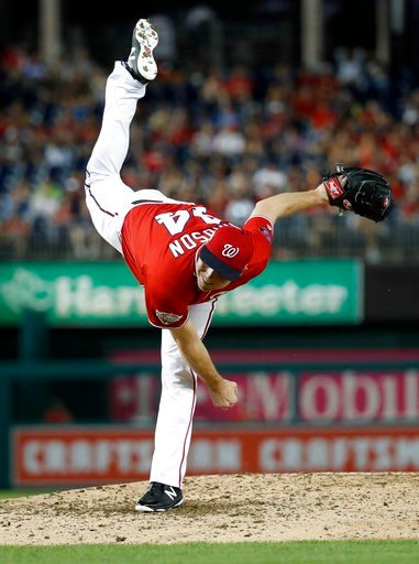 (AP Photo/Alex Brandon). Washington Nationals reliever Ryan Madson watches a pitch during the eighth inning of the second baseball game of a doubleheader against the Cincinnati Reds at Nationals Park, Saturday, Aug. 4, 2018, in Washington. The National...