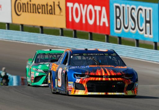 (AP Photo/Julie Jacobson). Chase Elliott (9) leads Kyle Busch (18) during a NASCAR Cup series auto race, Sunday, Aug. 5, 2018, in Watkins Glen, N.Y.